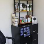veterinary product stand on top of black filing cabinet